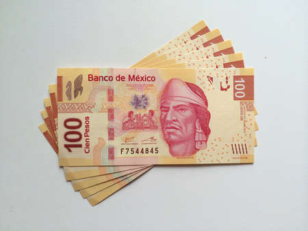 pesos: One hundred pesos bills over white  Stock Photo