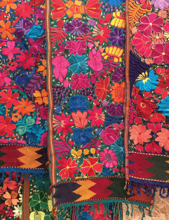 woven: Embroidered, full of color, floral table runners from San Miguel de Allende, Mexico Stock Photo