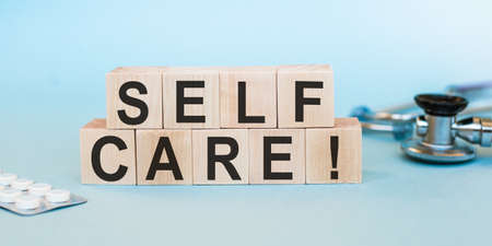 Self Care written on wood cubes. Medicine concept for Taking caring for own Health