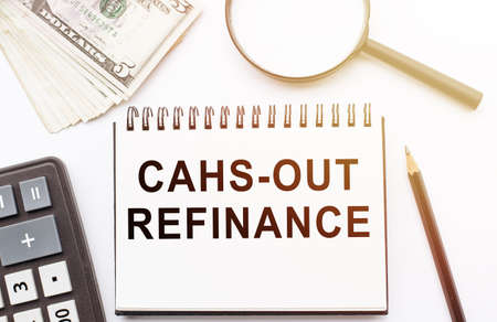 Cash out refinance text on documents on table Standard-Bild