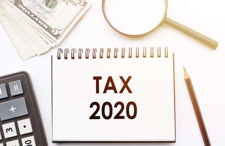 Business finance Concept - Tax time 2020 text on Note pad