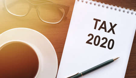 White notebook with text Tax 2020, concept 免版税图像