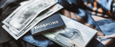 passport with money and bus ticket on hand luggage