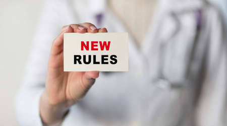 Text New Rules written on note paper putting in a pocket by a doctor. Medical concept. Banque d'images