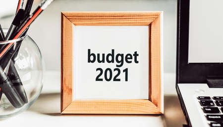 Budget 2021 text in wooden frame on office table