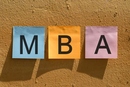 Getting your MBA, close-up of colorful stickers with MBA text