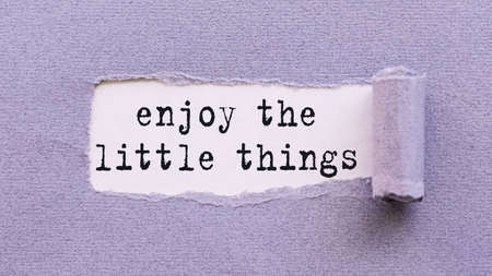note on torn paper - Enjoy the little things - reminding us to appreciate even the simple moments in life