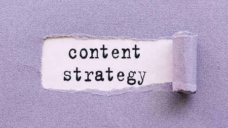 The text Content strategy appears on torn lilac paper against a white background