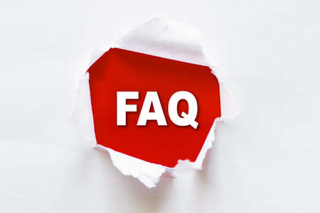 White torn paper with a word FAQ - Frequently Asked Questions.