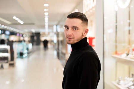 Portrait of a handsome young man in a shopping center