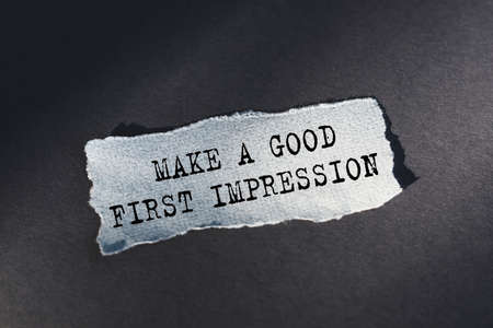 Make a good first impression - the text is written on torn paper with a blue background.