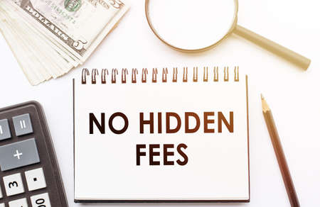 NO HIDDEN FEES - text written on a notebook with office background. Archivio Fotografico