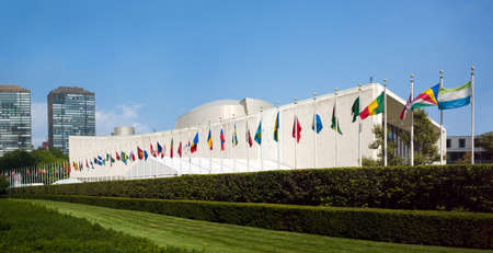 united nations: UN United Nations general assembly building with world flags flying in front - September 1, 2015, First avenue, New York City, NY, USA Editorial