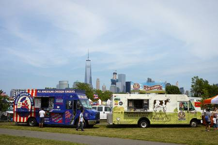 wtc: Yankee Doodle Dandys chicken tenders and Cheese curds trucks in park on independence day, WTC in background - July 4,2016, Liberty State Park, NJ, USA