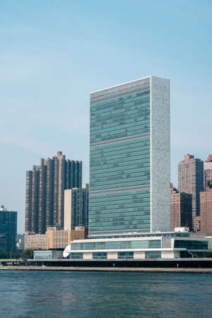 united nations: UN United Nations headquarters skyscraper as seen from Roosevelt Island. Corinthinan high-rise in the background.   - September 2, 2015, Four Freedoms Park, New York City, NY, USA