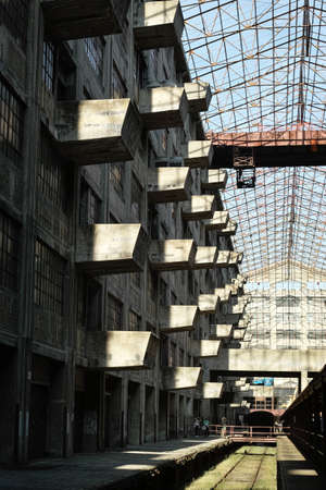 gilbert: Balconies of the Brooklyn Army Terminal on Open House New York Weekend lit by the afternoon sun while the rest of the wall is in dark shade.