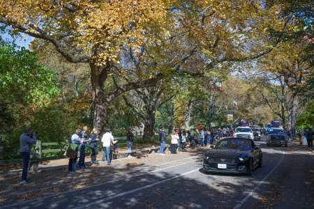 escort: Escort vehicles before female frontrunner driving by the crowd of spectators in Central Park before 25 mile marker - November 6, 2016, East Drive, New York City, NY, USA