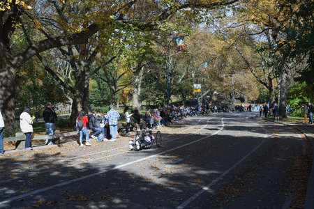 Handycycle competitor riding by the crowd of spectators in Central Park - November 6, 2016, East Drive, New York City, NY, USA