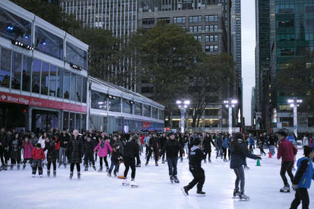 People ice skating in Bryant Park on Thanksgiving day - November 24, 2016 6th Avenue, New York City, NY, USA
