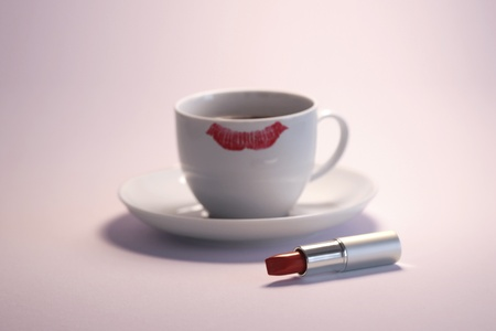 Lipstick and cup with lipstick mark photo