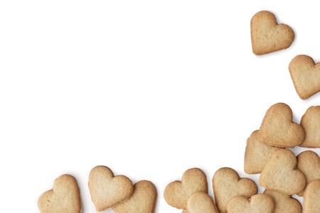 bizcochos: Heart-shaped cookies sobre fondo blanco