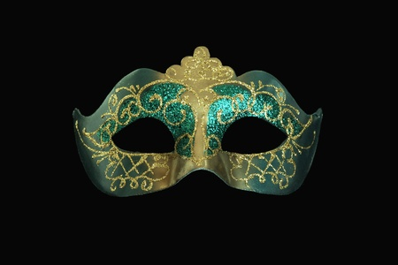Ornate golden and turquoise carnival mask photo