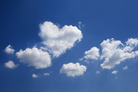 heartshaped: Blue sky with heart-shaped cloud  Stock Photo