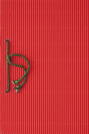 cordon: Red paper notebook cover bound with green cord Stock Photo