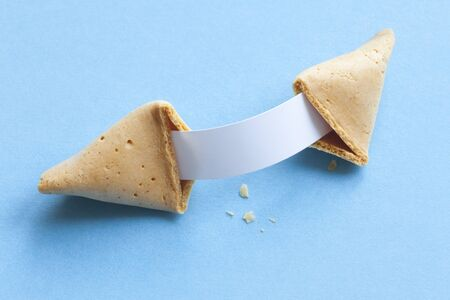 Broken fortune cookie with blank message Stock Photo