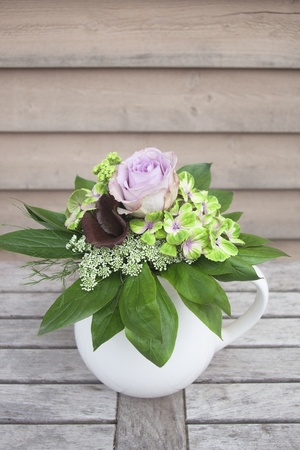 Mixed bouquet on wooden table photo