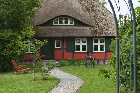 thatched house: Traditional house with thatched roof and garden in Mecklenburg-Western Pomerania, Coast of the Baltic Sea, Germany, Europe Editorial
