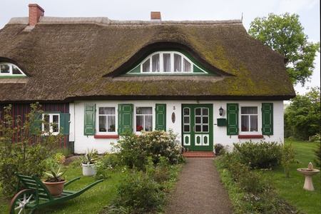 thatched house: Traditional house with thatched roof and garden in Born, Fischland-Darss-Zingst, Coast of the Baltic Sea, Mecklenburg-Western Pomerania, Germany, Europe Editorial