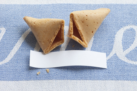 good fortune: Broken fortune cookie with blank message Stock Photo