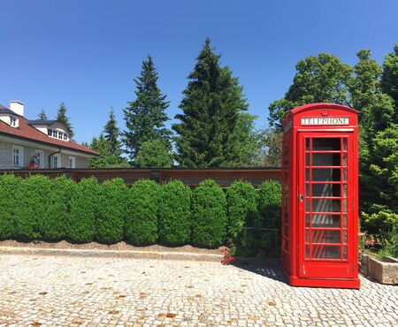 red telephone: Red telephone booth in a small village Stock Photo