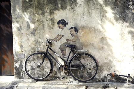 PENANG MALAYSIA  APRIL 26 2015: Penang street art  kids on bicycle