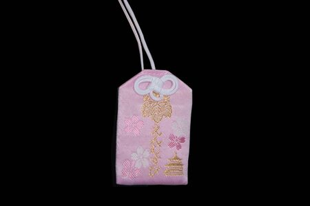 lucky charm: Omamori  japanese charm which brings luck in love to its owner Stock Photo