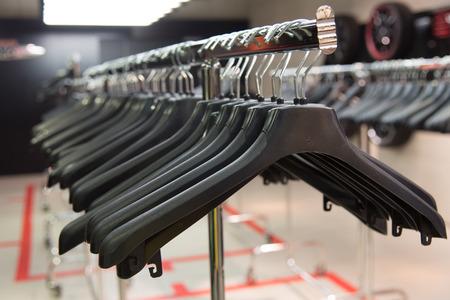 checkroom: Cloth Rack with hangers Stock Photo