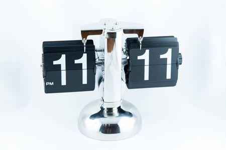 analogous: Isolated vintage flip clock on white background