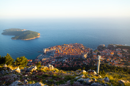 srd: View of Dubrovnik old town and Lokrum island from Srd mountain during sunset