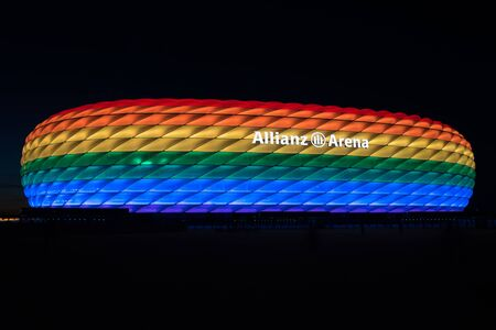 christopher: MUNICH, GERMANY - 9 JULY 2016: Allianz Arena illuminated in rainbow light on Christopher Street Day