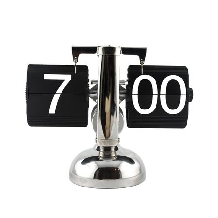 seven o'clock: Isolated vintage flip clock on white background at seven oclock