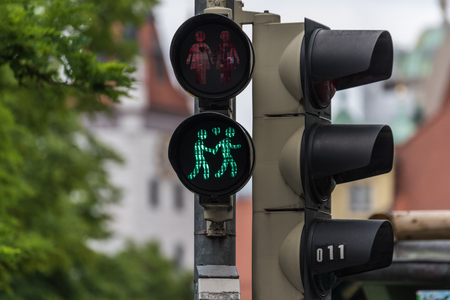 sex traffic: Green traffic light with a same-sex couple symbol in Munich to celebrate the pride week Stock Photo