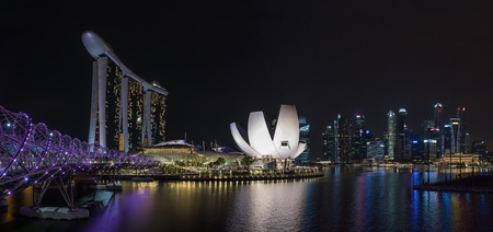 View of Singapore skyline at night with Helix bridge, Hotel Marina Bay Sands and art science museum