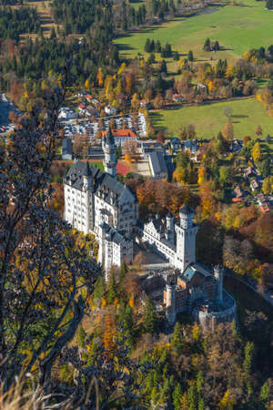 View of the world famous Neuschwanstein castle in autumn  event from the vantage point on Tegelberg Editorial