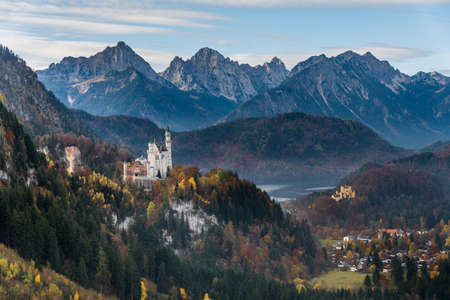 View of Neuschwanstein castle and Hohenschwangau castle from cable car to the top of the Tegelberg with mountain view in autumn as background