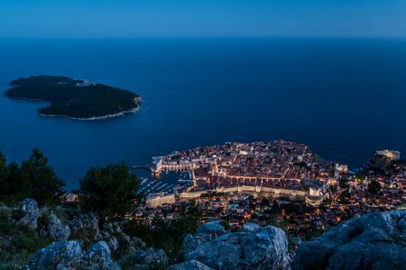 Night view of Dubrovnik old town and Lokrum island, Croatia