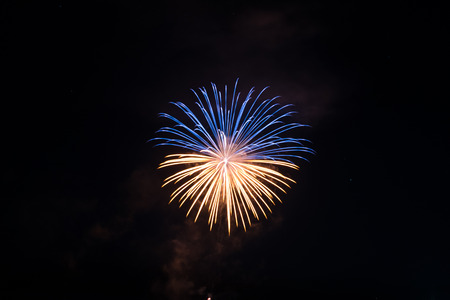 Beautiful single firework in gold and blue