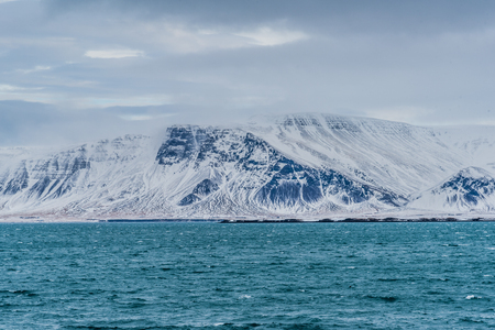 View of Mount Esja, Reykjavik, Iceland on a cloudy day in winter