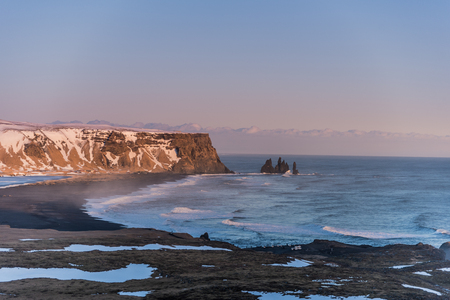 View over Reynisfjara or black beach during sunset