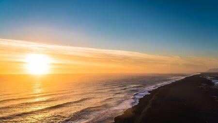 Sunset at the black sand beach Stock Photo